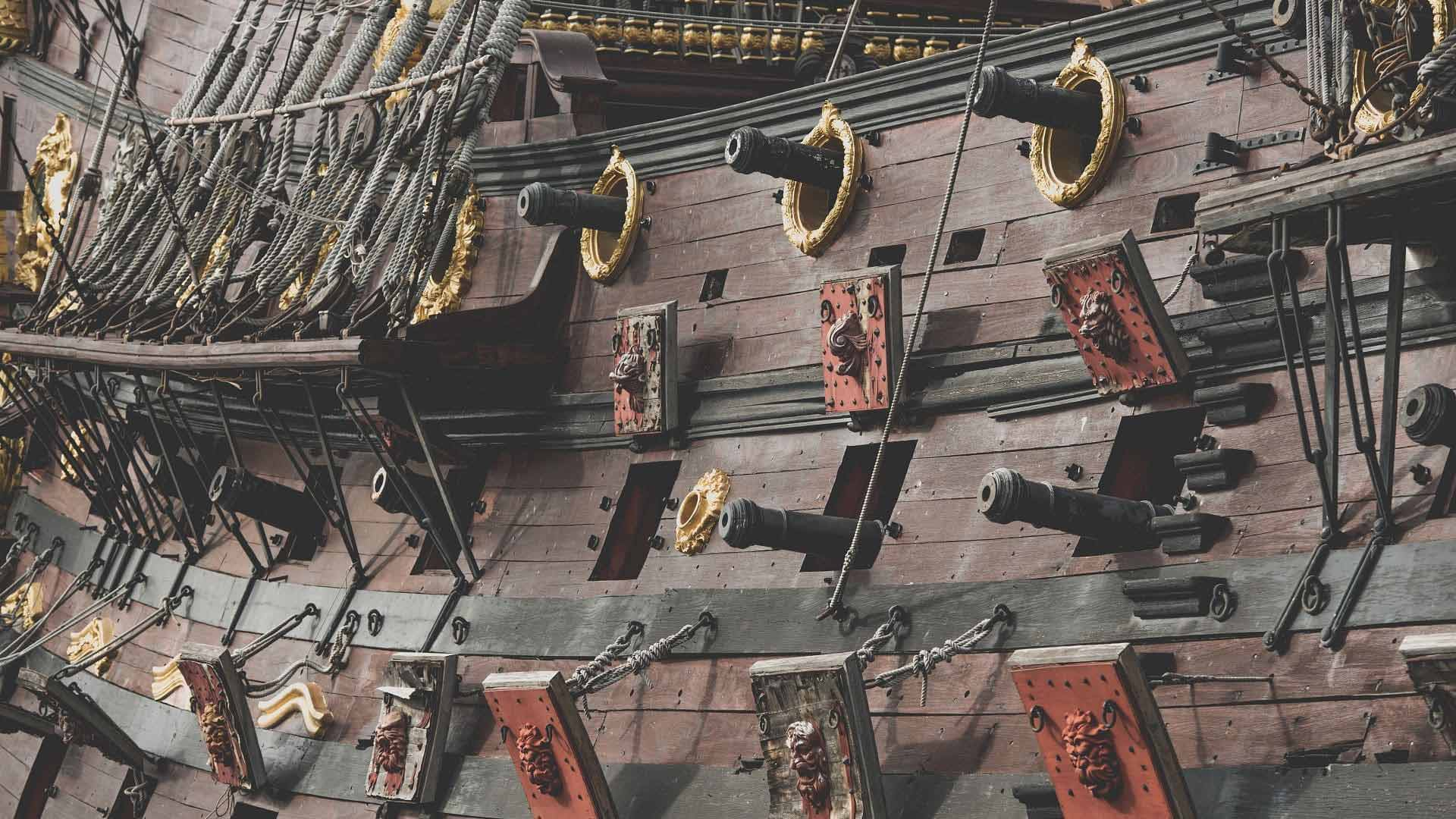 Cannons sticking out from the side a Spanish galleon sailing ship