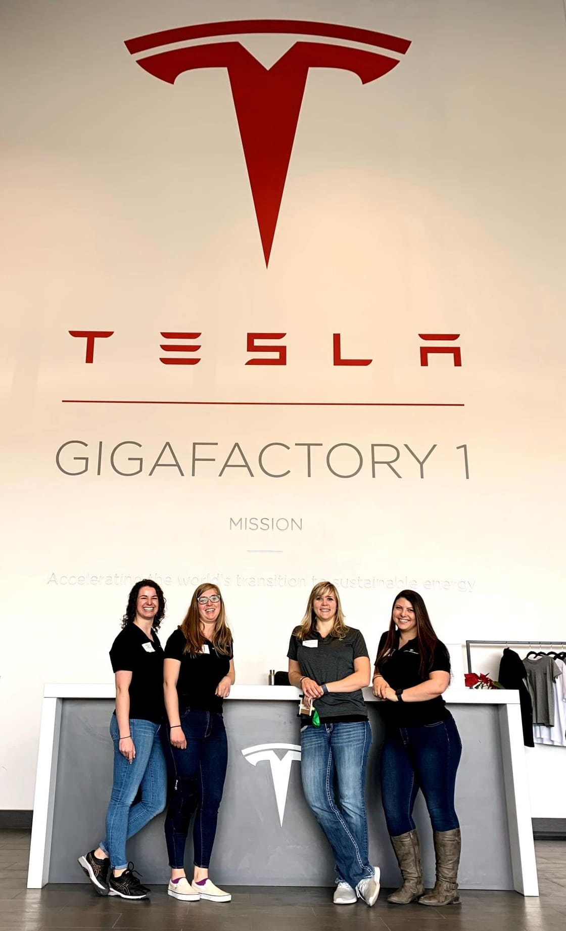 "Lexi Robertson (left) with 3 cowokers from Wood Rogers volunteering at Tesla's ""Introduce a Girl to Engineering Day"" Feb. 2019."