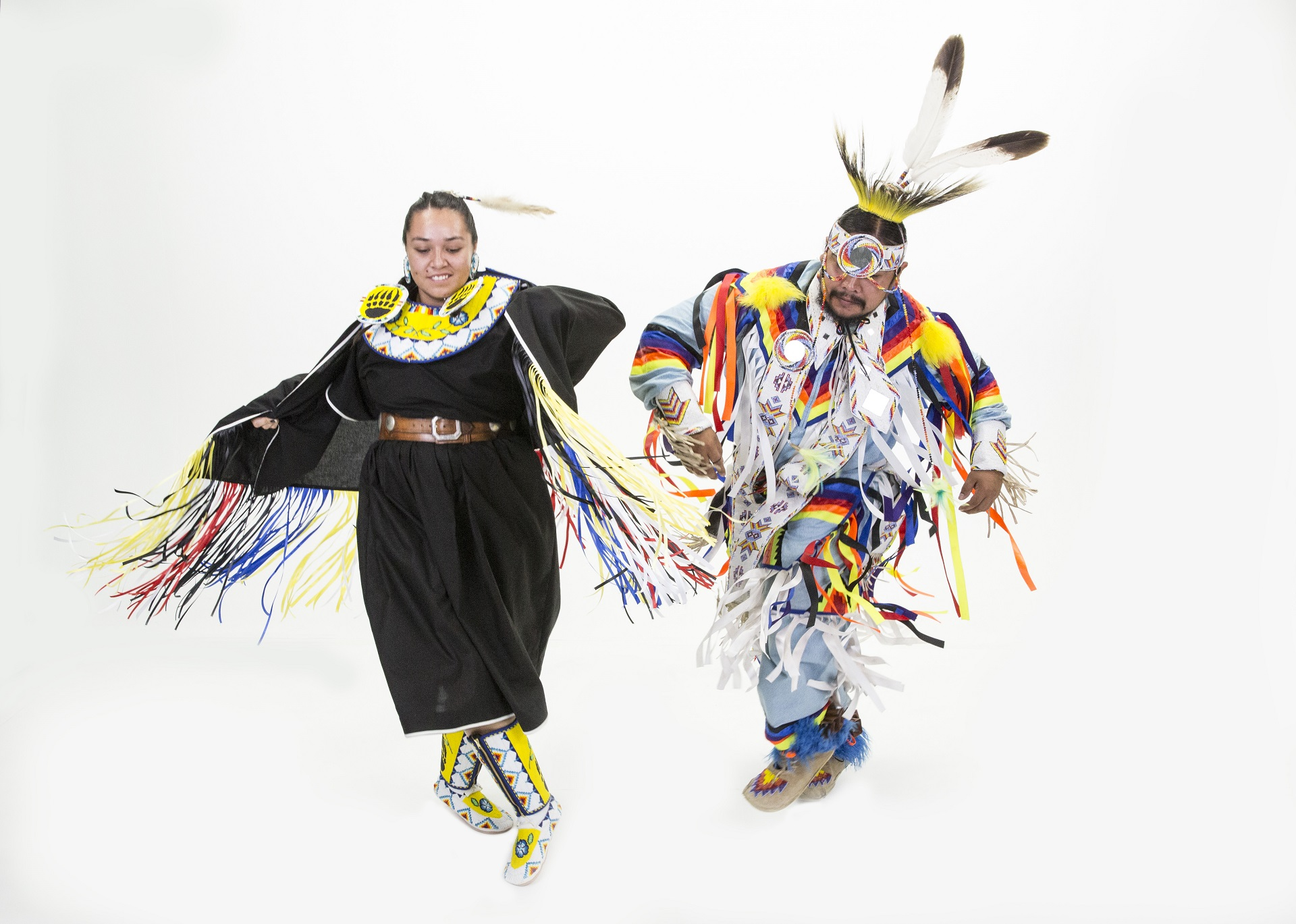 Pow wow dancers in full garb