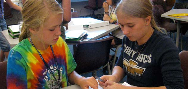 Two girls work together at an engineering camp