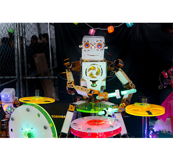 A Robot plays the drums at a Maker Faire