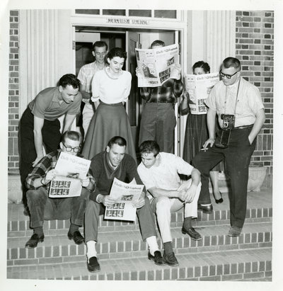 Students reading the Sagebrush student newspaper, antique photo