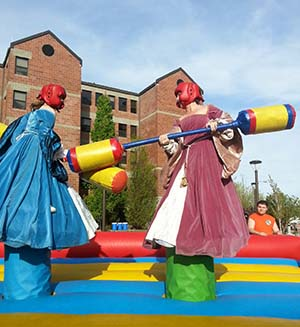 Allison Blair and friend jousting in Tudor dresses