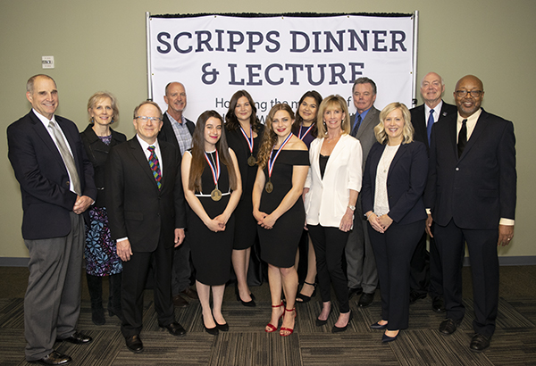 Members of the Scripps Family, Scripps scholarship recipients, university faculty and the Scripps speaker pose indoors.
