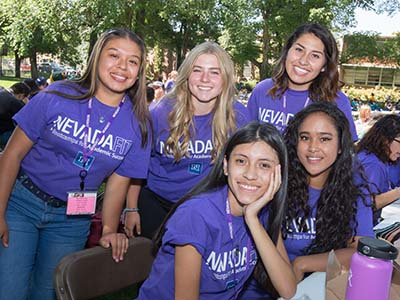 NevadaFIT HealthFIT students in purple shirts outside on the UNR Quad