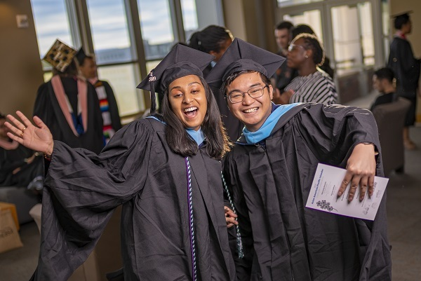 Two grads having a great time at the Asian American & Pacific Islander Graduate Celebration