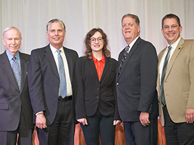 Chester Newland, Gregory Mosier, Isabella F. Kline, Sterling Franklin and Frederick Steinmann posing together on stage.