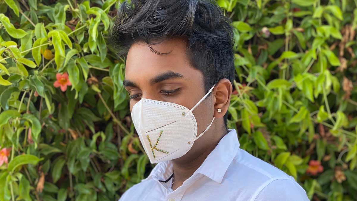 Kevin Sivakumar wearing a mask with a monogram K