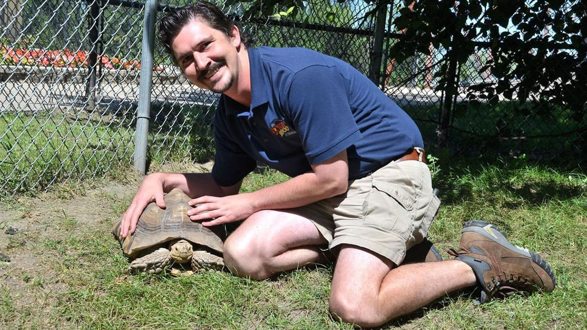Logan Wood with a tortoise