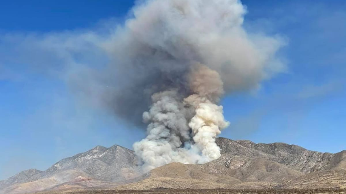 The Sandy Valley Fire burns a mountainside in Southern Nevada.