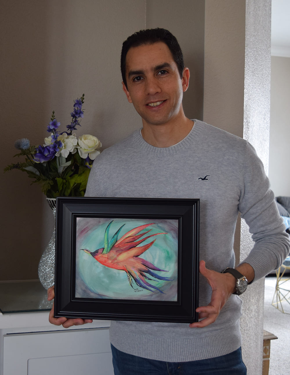 Ahmed Akl holding painting