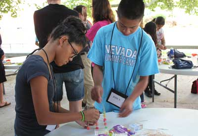 Two students work on a gumdrop structure at MESA camp