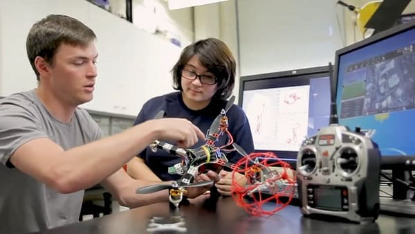 Students working on drone together