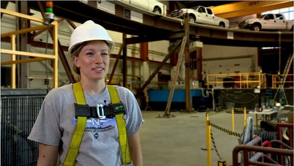 Student with hard hat in earthquake engineering laboratory