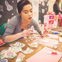 Su'ad Yoon working with paper crafts