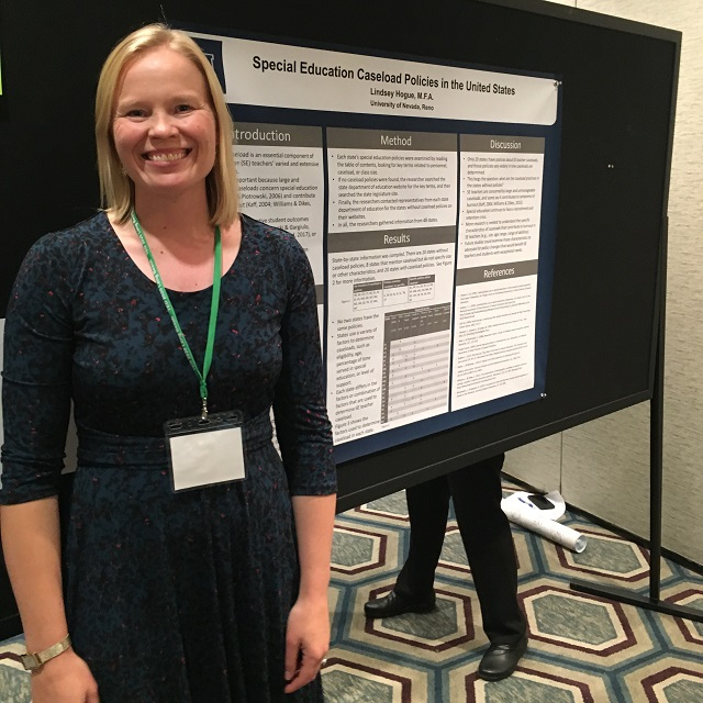 Lindsey Hogue standing next to presentation poster of her research