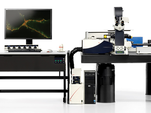 Computer next to a confocal microscope