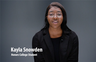 """Headshot of Kayla Snowden with the words """"Kayla Snowden, Honors College Student"""" in the bottom left corner."""
