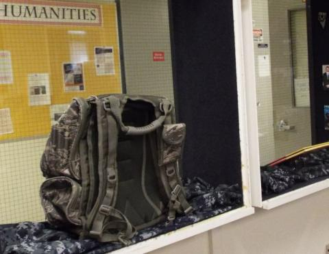 Army back pack in glass case of Shared History Exhibit
