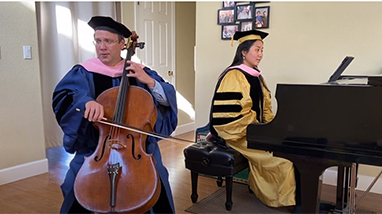 Dmitri Atapine playing cello and Hyeyeon Park playing piano in graduation regalia