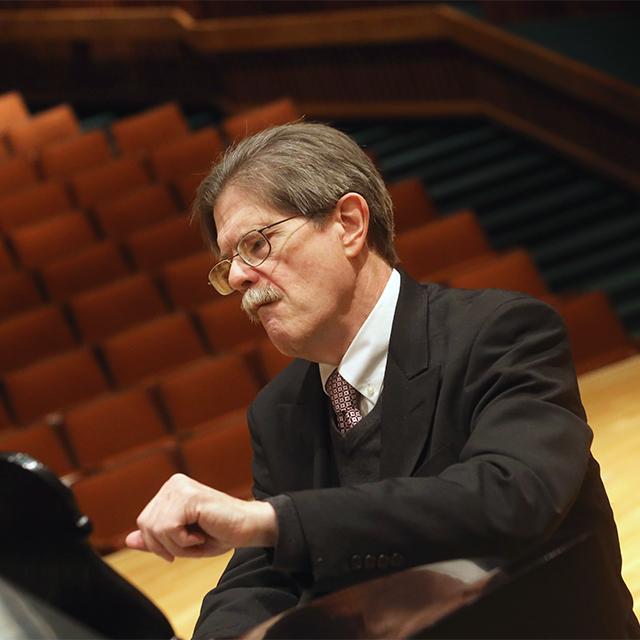 James Winn at a piano.