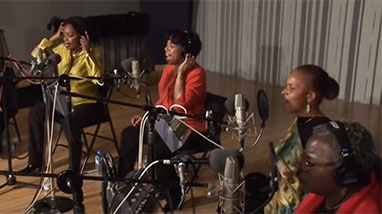 Members of the Sweet Honey band sit in studio and record music