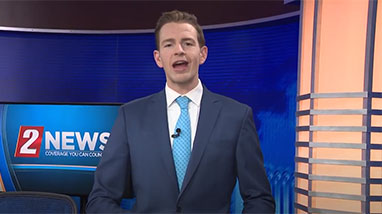 Landon Miller on camera giving interview
