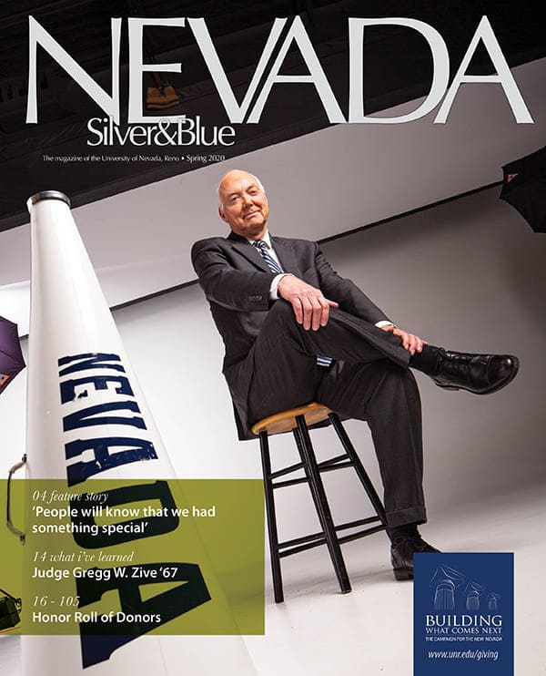 The cover of the Spring 2020 issue of Nevada Silver and Blue magazine is a photo of outgoing University president Marc A. Johnson getting ready for a photoshoot.