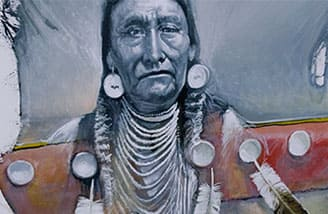 A pencil sketch of a male member of the Paiute Tribe drawn on a easel