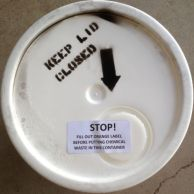 Bucket lid with a label reading 'keep lid closed'