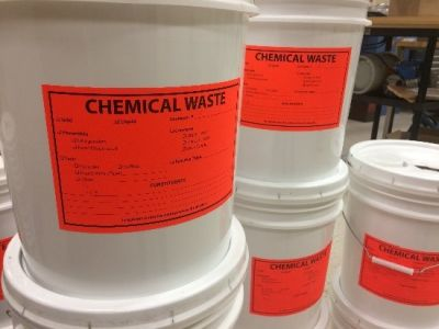 "A bucket labeled ""Chemical Waste"""