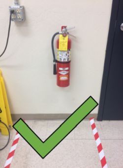 A fire extinguisher which is accessible and safe to approach