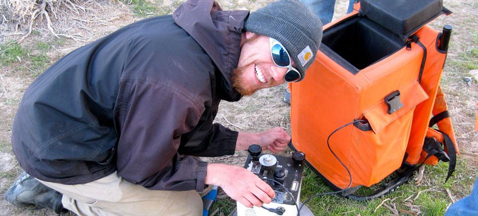 Paul Schwering takes a gravity measurement at Astor Pass (Pyramid Lake)