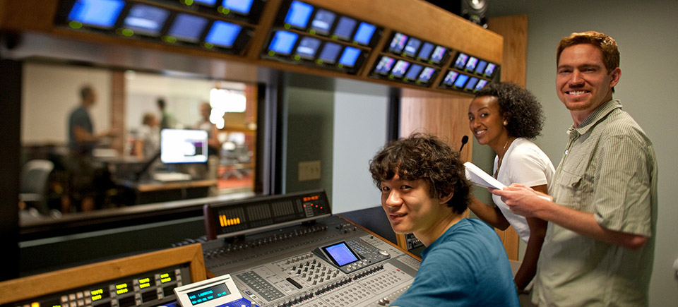 Journalism students in a control room