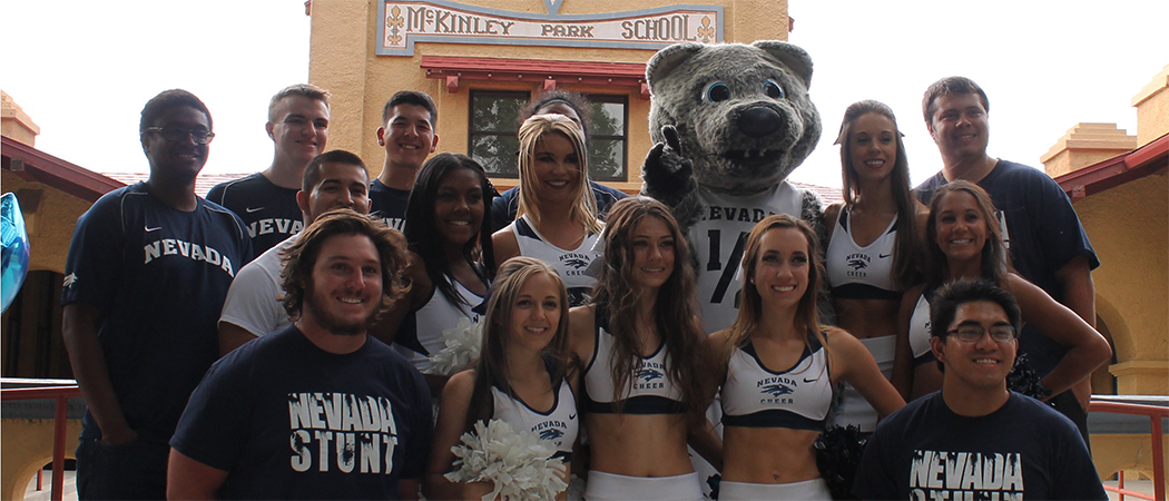 A group of cheerleaders standing with Alphie, Jr., the UNR mascot