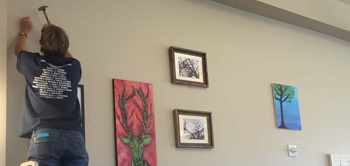 Cheryll Glotfelty prepared tree-themed student artwork