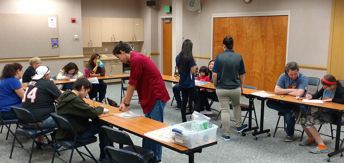 University students help participants during Mobile Engineering Education Lab at the Northwest Reno Library, May 21.