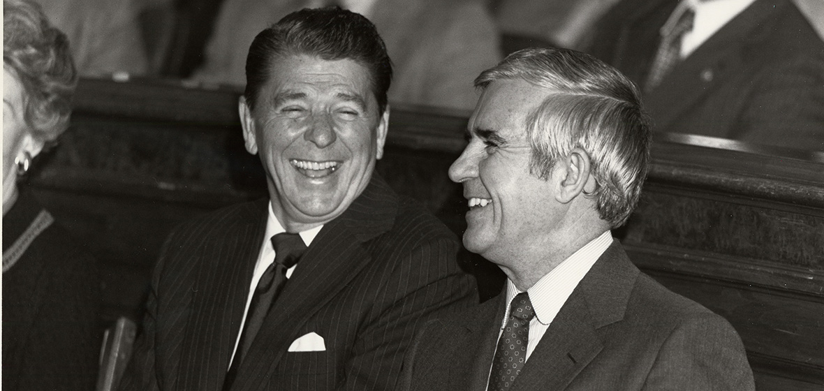 President Ronald Reagan with Paul Laxalt, both wearing suits and laughing