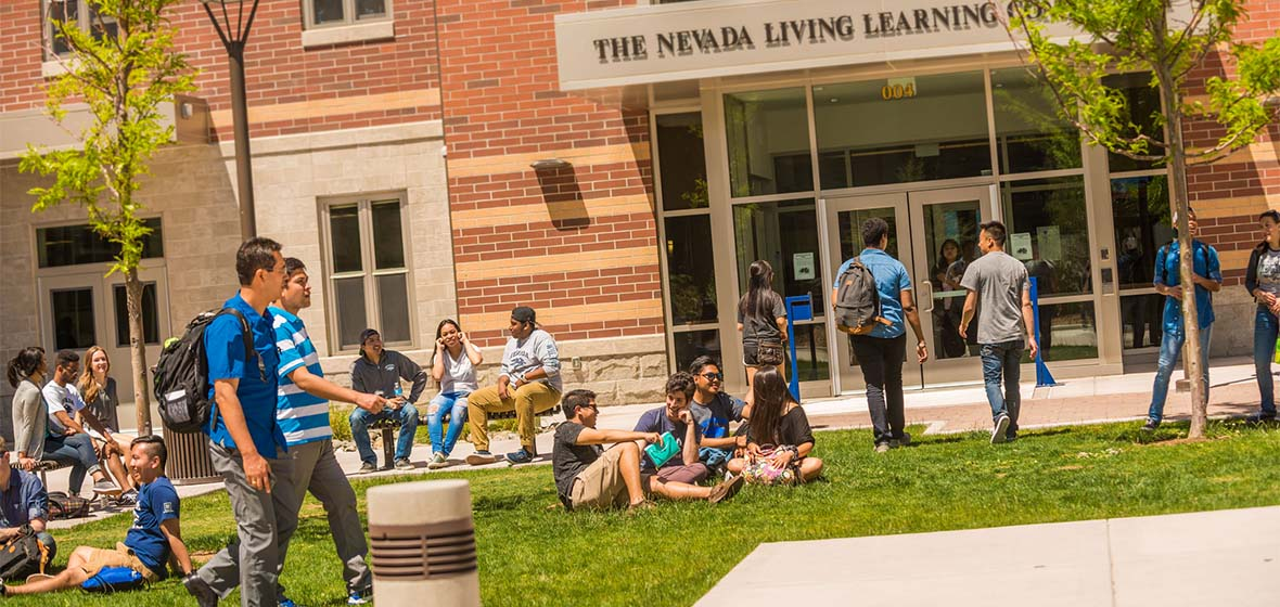 Picture of the Nevada Living Learning Community in Daylight with Students in Front Relaxing and Going About Their Business.