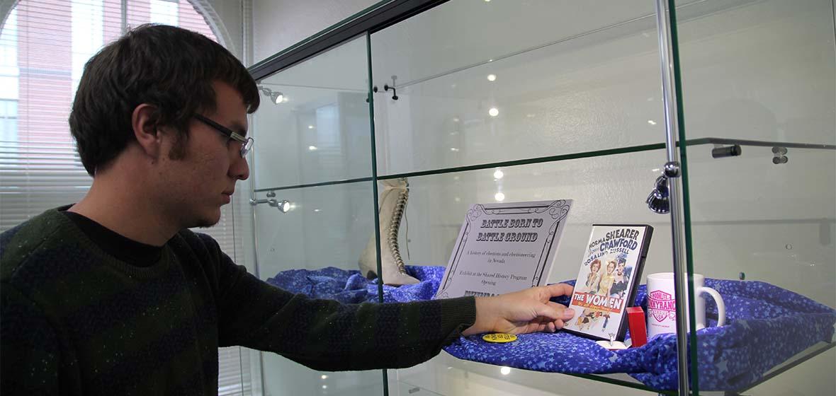 Student preparing for the Nevada politics exhibit