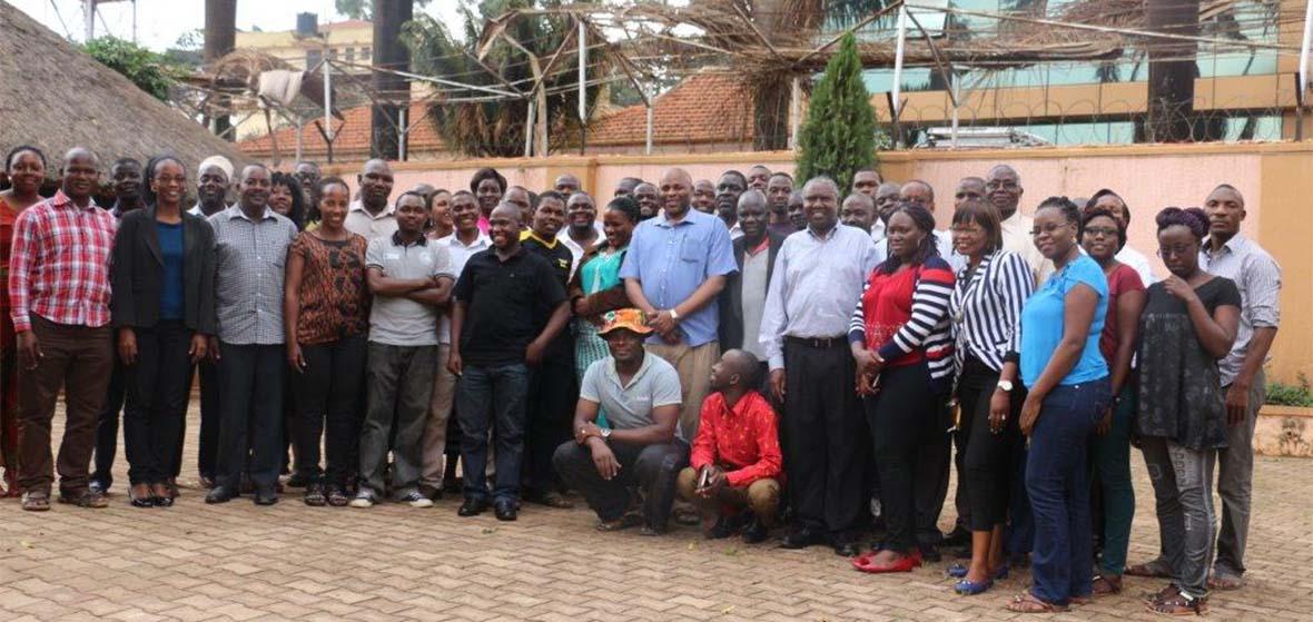 Makoba posing with UTAMU Graduate students, staff and administrators