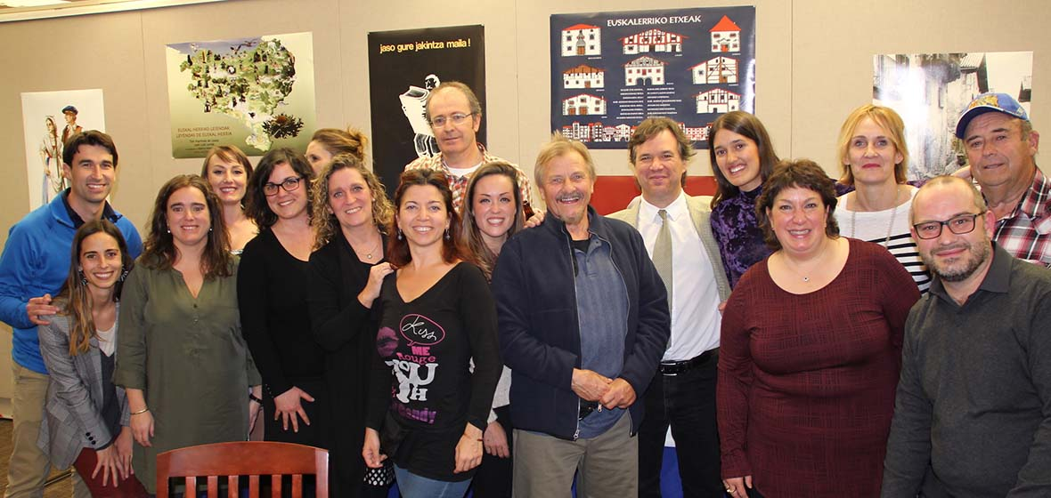 Group of people pose in Basque library during 50th anniversary reception for the Center for Basque Studies