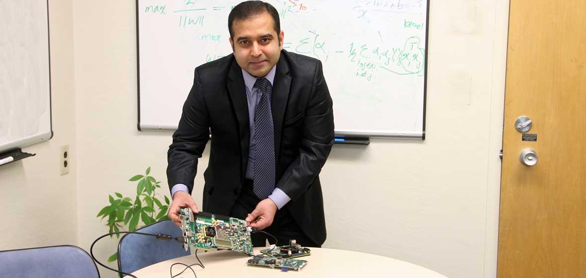 Arslan Munir with a prototyping board