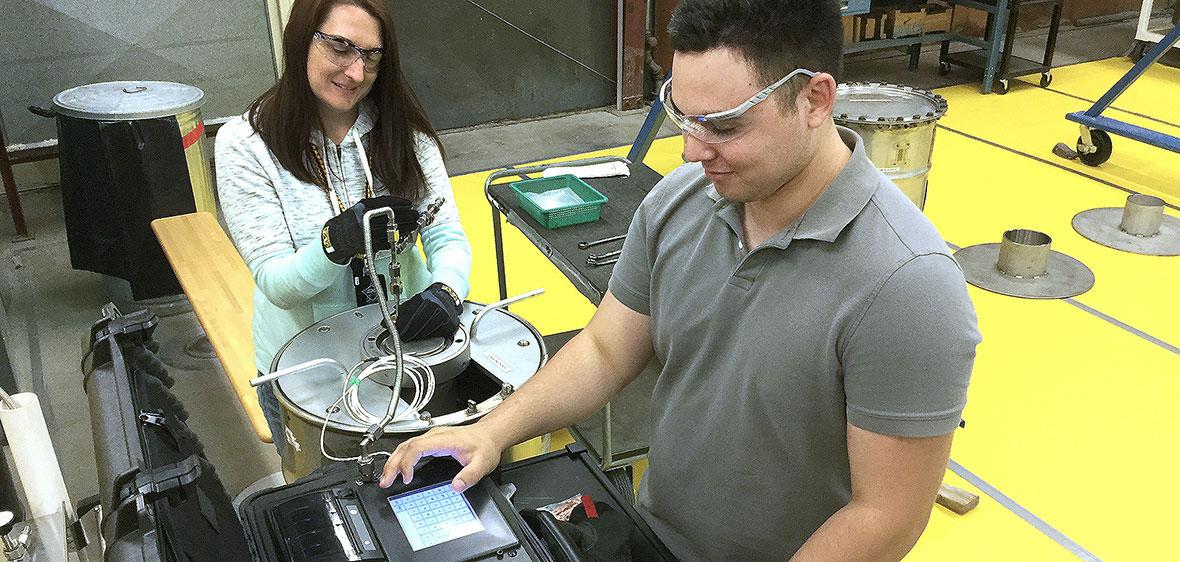 Daniel Perlstein works on leak test machine