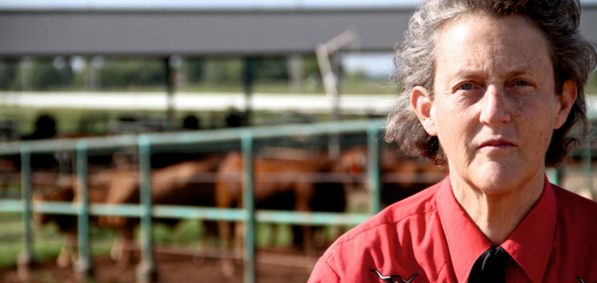 Temple Grandin in front of one of her facilities