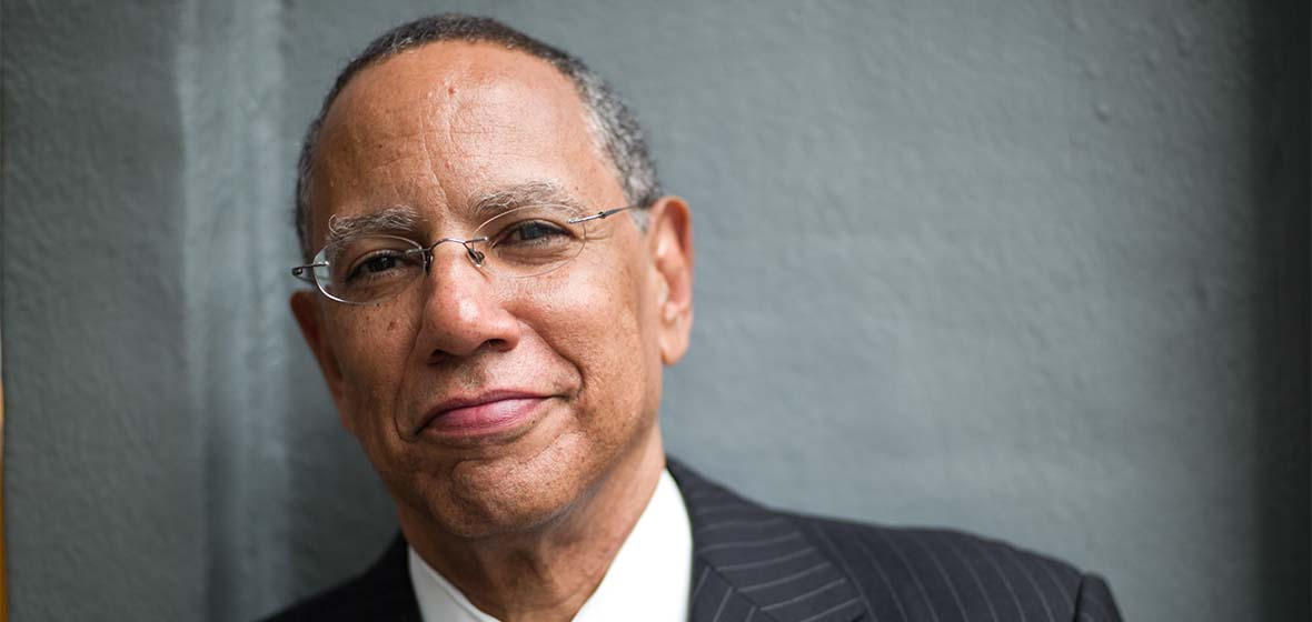 Dean Baquet poses for the camera.