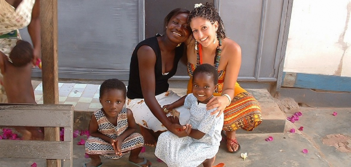 Friendly USAC participant sits with a mother and two children