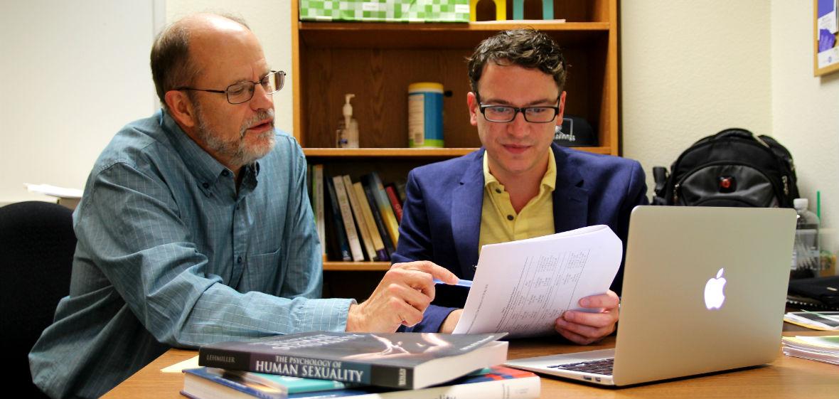 Dan Weigel and Randal Brown looking over reseach in office