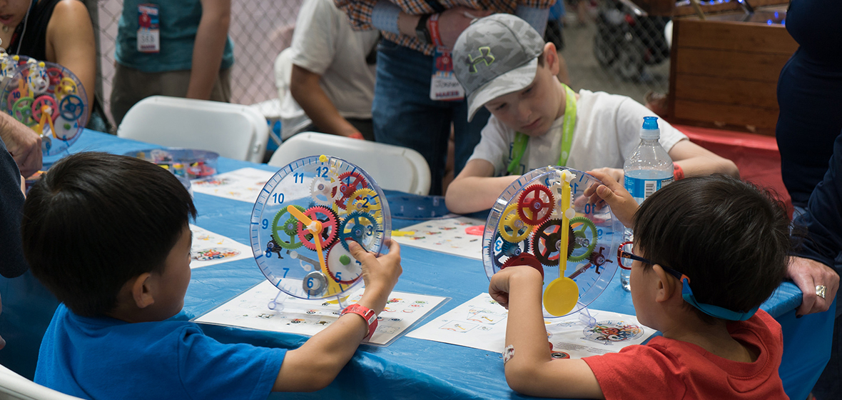 A group of kids participate in a Maker Faire