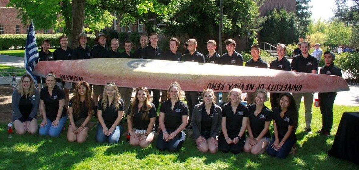 2017 UNR concrete canoe team pose next to their canoe